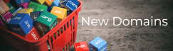 New Domains Available From December. Image Is Of A Shopping Basket On A Floor With Lots Of Coloured Blocks With Domain Names On Them Inside The Basket, A Couple Of The Blocks Have Fallen On To The Floor From The Basket.